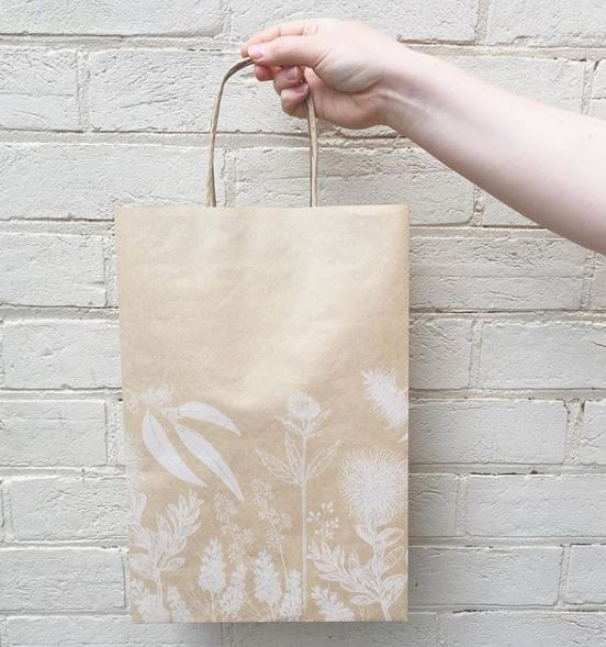 Image of PaperPak Matilda Bag being held up with gum tree design