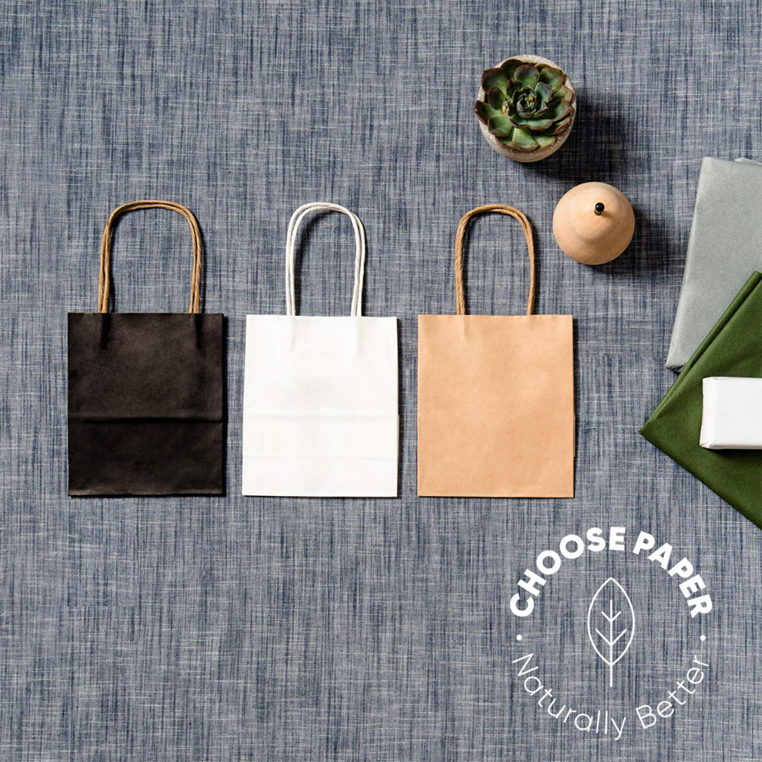 "Image of three paper carry bags with logo ""Choose paper. Naturally Better""."